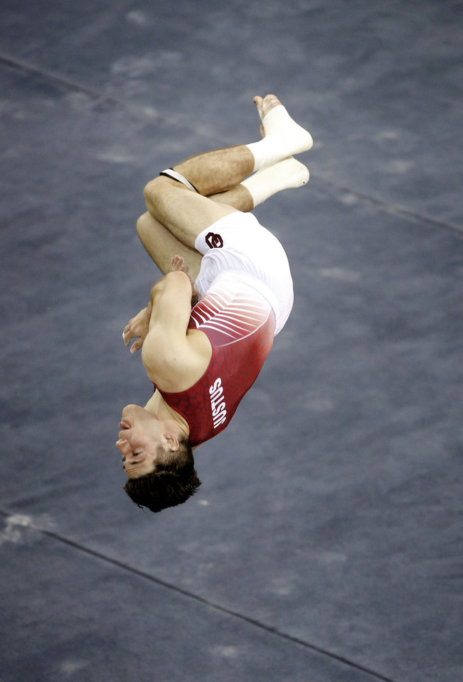 Photo - Oklahoma's Tanner Justus competes in the floor exercise during a gymnastics meet with Illinois at McCasland Field House in Norman, Okla., Saturday, March 18, 2017. Photo by Bryan Terry, The Oklahoman