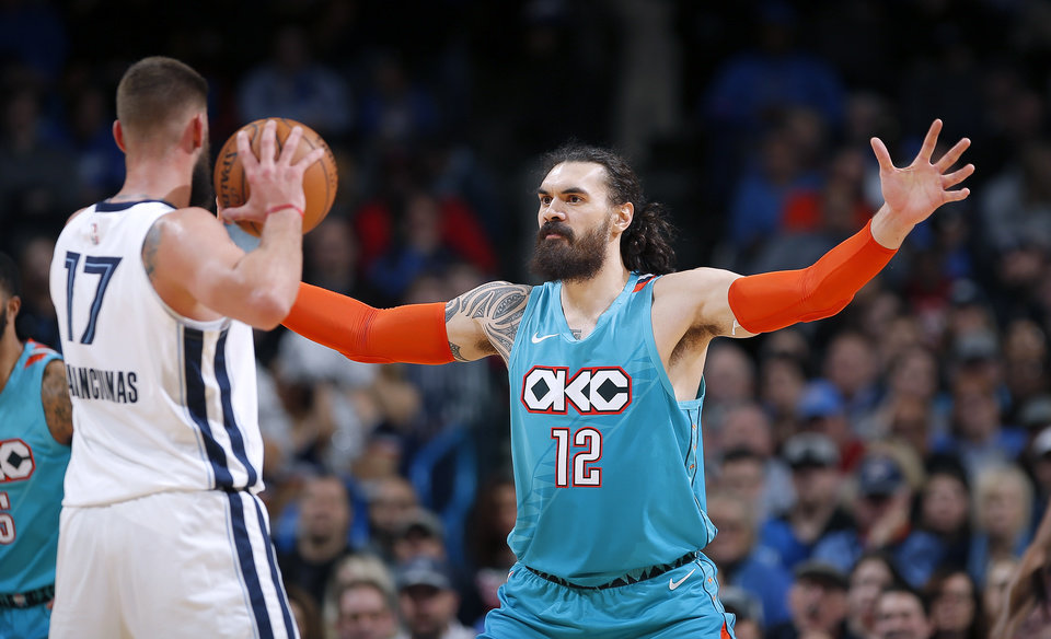 Photo - Oklahoma City's Steven Adams (12) defend against Memphis' Jonas Valanciunas (17) during the NBA basketball game between the Oklahoma City Thunder and the Memphis Grizzlies at the Chesapeake Energy Arena, Sunday, March 3, 2019. Photo by Sarah Phipps, The Oklahoman