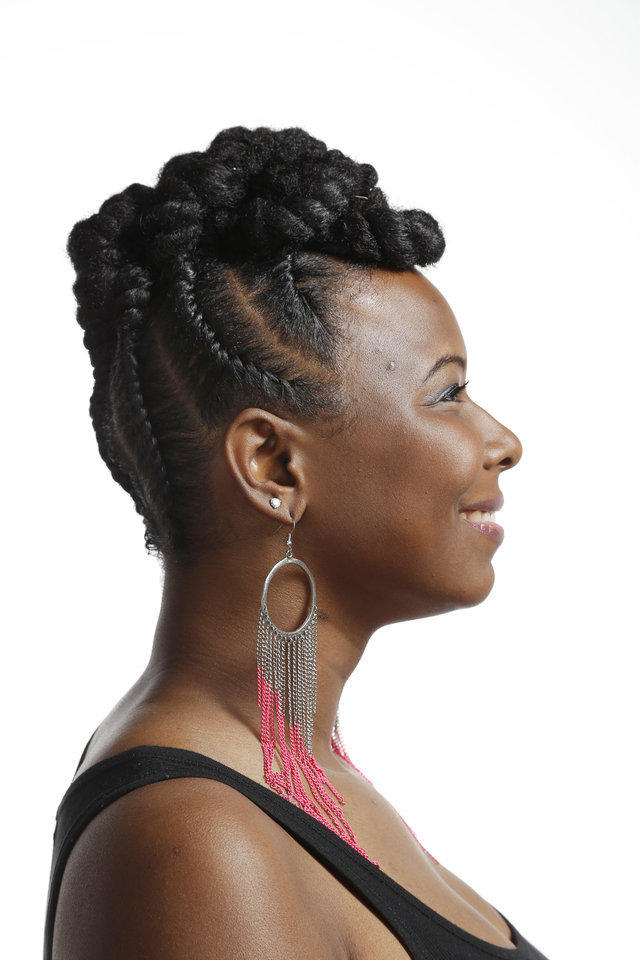 Photo - Nicole Owens wears her natural black hair in an updo by Desiree Irving of The Hair Cafe. Photo by Doug Hoke, The Oklahoman.  DOUG HOKE