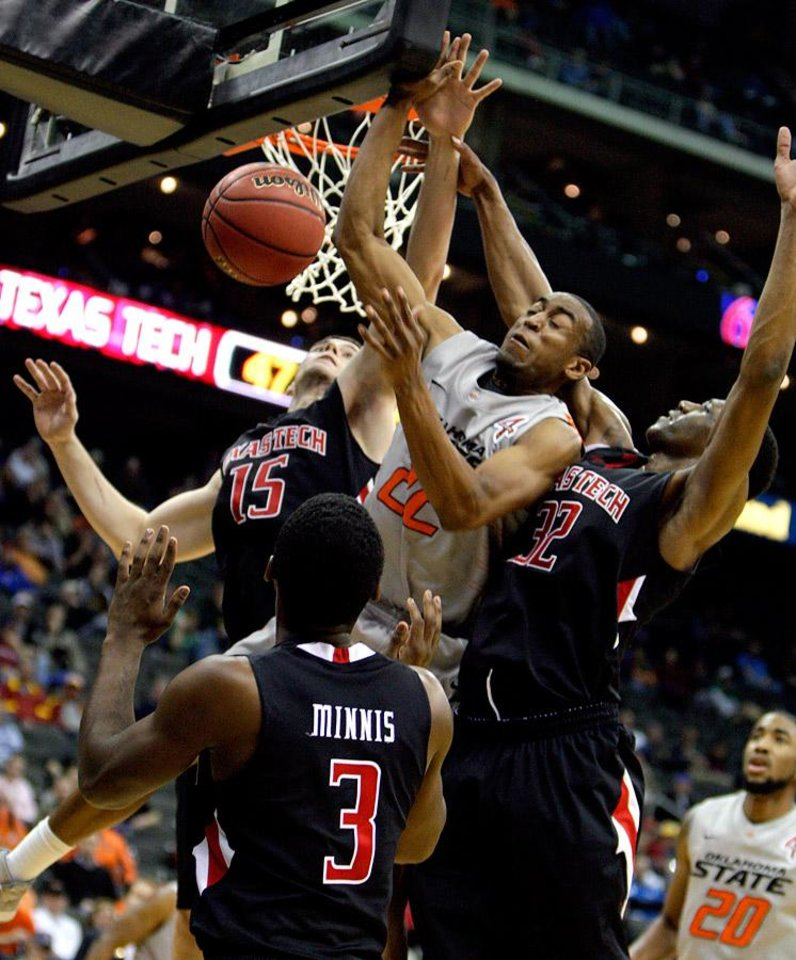 Photo -  Oklahoma State's Markel Brown (22) fights for a rebound with Texas Tech's DeShon Minnis (3), Robert Lewandowski (15) and Jordan Tolbert (32) during the Big 12 tournament men's basketball game between the Oklahoma State Cowboys and the Texas Tech Red Raiders at the Sprint Center, Wednesday March 7, 2012. Photo by Sarah Phipps, The Oklahoman