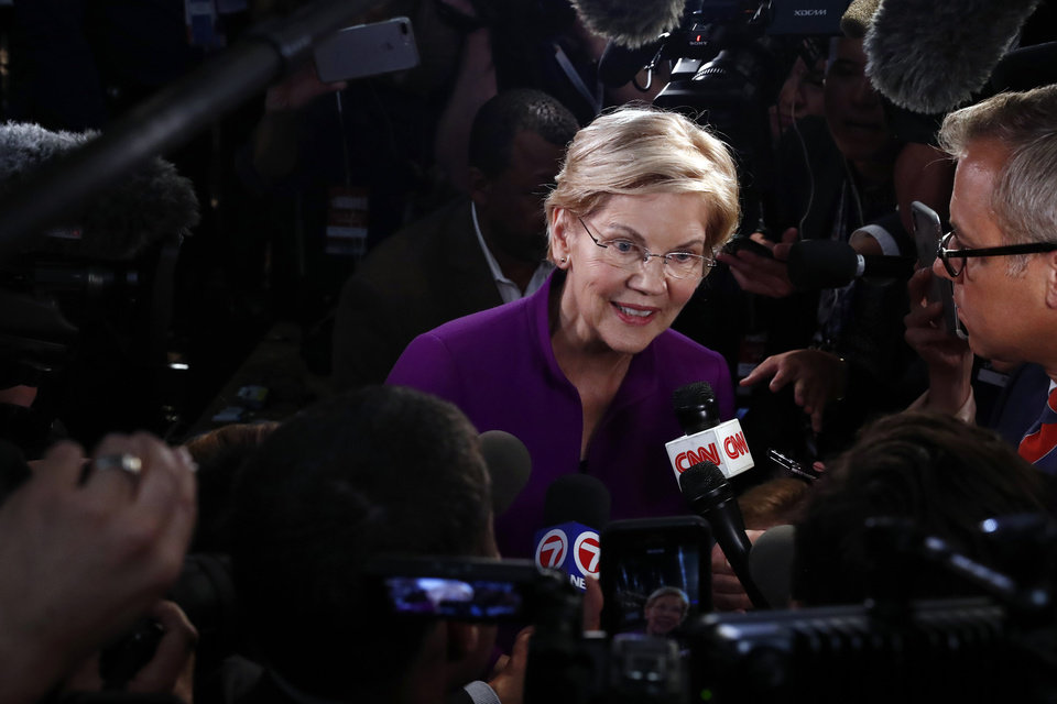 Photo - Democratic presidential candidate Sen. Elizabeth Warren, D-Mass., answers questions after a Democratic primary debate hosted by NBC News at the Adrienne Arsht Center for the Performing Arts, Wednesday, June 26, 2019, in Miami. (AP Photo/Brynn Anderson)