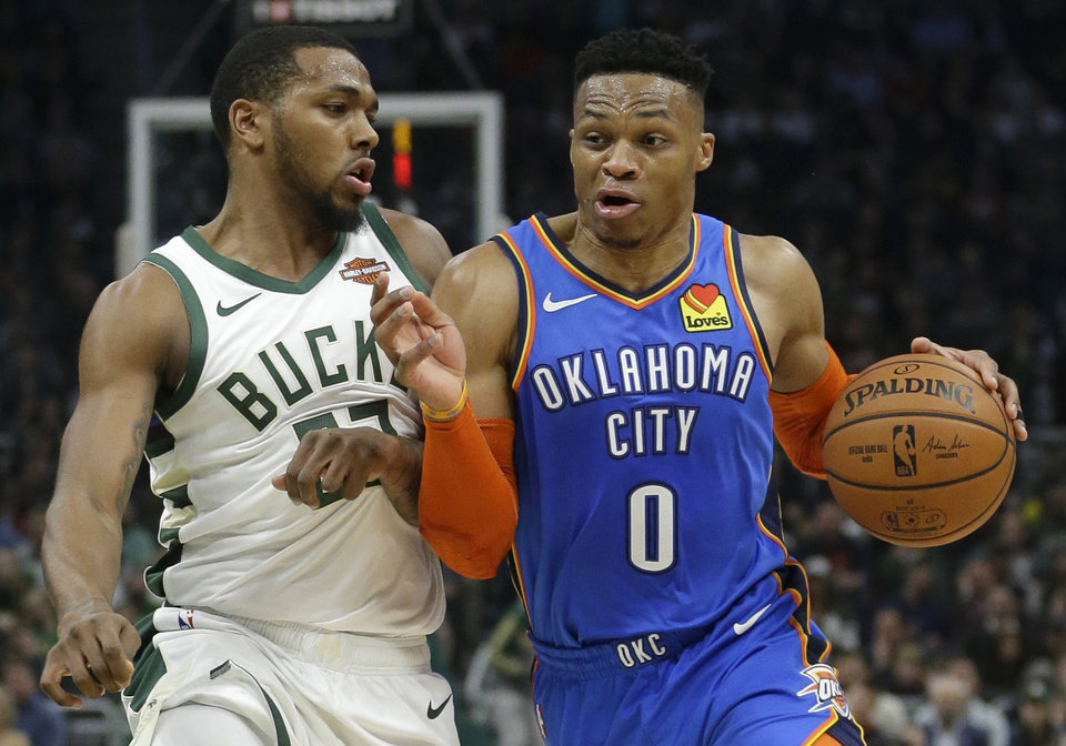 Photo - Oklahoma City Thunder's Russell Westbrook drives to the basket against Milwaukee Bucks' Sterling Brown during the first half of an NBA basketball game Wednesday, April 10, 2019, in Milwaukee. (AP Photo/Aaron Gash)
