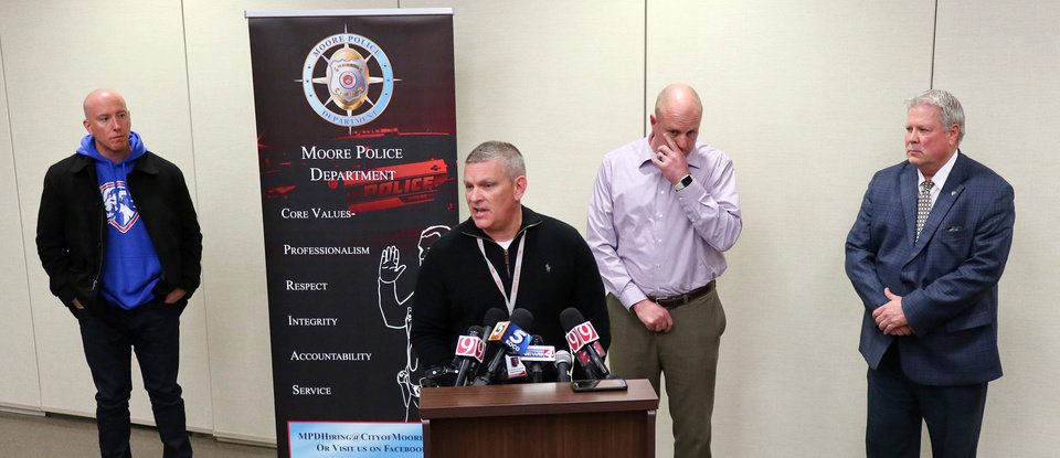 Photo - Moore schools superintendent Dr. Robert Romines talks at a news conference about the Moore High School students that were run over by a pickup truck Monday, on Tuesday, February 4, 2020. Behind him is Dustin Horstkoetter, Sgt. Jeremy Lewis and Chief Todd Strickland. [Photo by Doug Hoke/The Oklahoman]