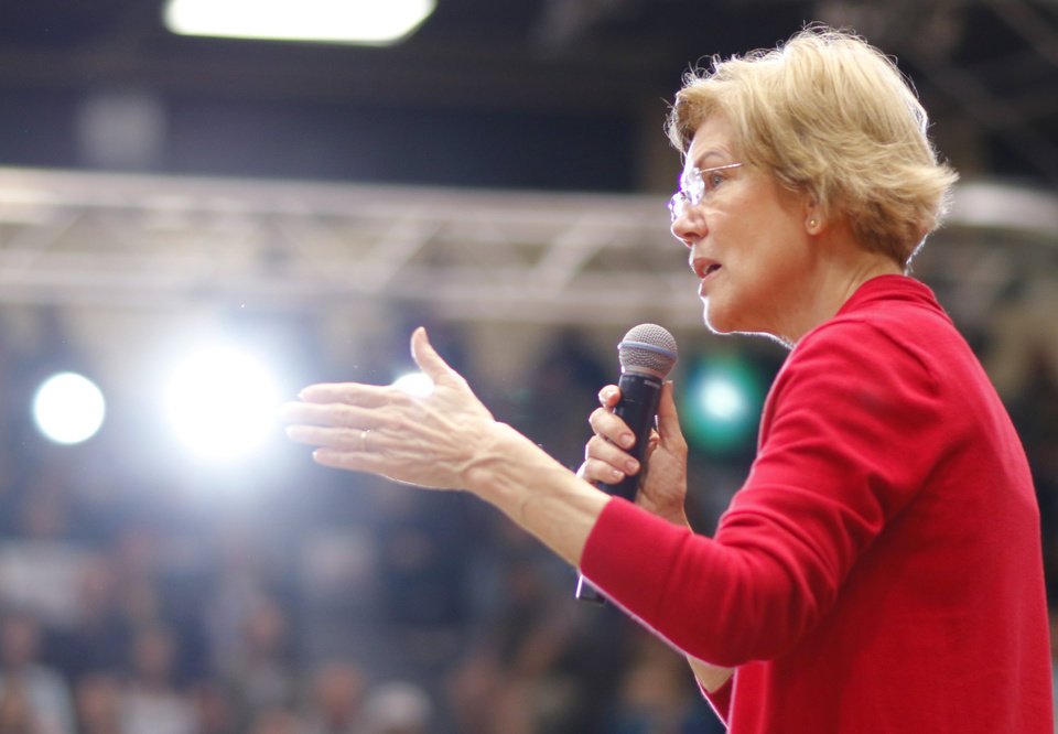Photo - Sen. Elizabeth Warren fires up the crowd during an Elizabeth Warren campaign stop in Oklahoma City at Northwest Classen High School, her alma mater, Sunday, December 22, 2019. [Photo by Doug Hoke/The Oklahoman]