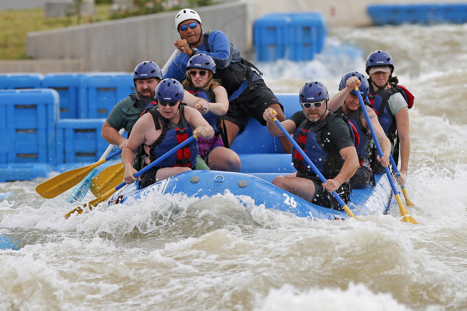 Photo - Rafters from The Oklahoman Media Company compete in the RIVERSPORT Whitewater Rafting League Championship during the Stars & Stripes River Festival in Oklahoma City, Saturday, June 24, 2017. Photo by Bryan Terry, The Oklahoman