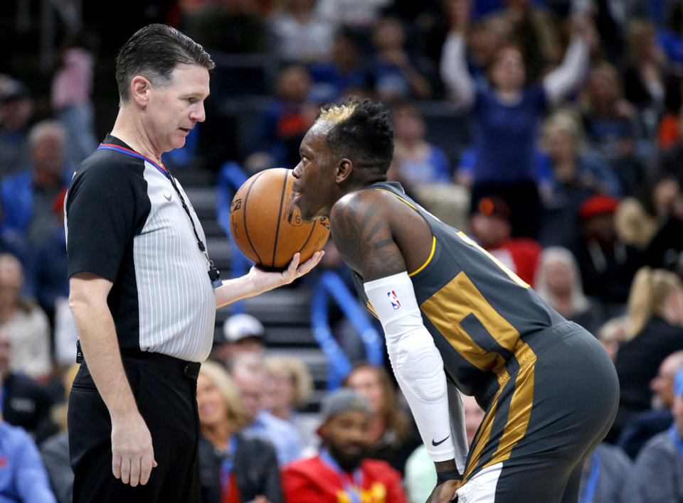 Photo - Oklahoma City's Dennis Schroder (17) argues for a call during the NBA basketball game between the Oklahoma City Thunder and the Denver Nuggets at the Chesapeake Energy Arena in Oklahoma City,  Friday, Feb. 21, 2020.  [Sarah Phipps/The Oklahoman]