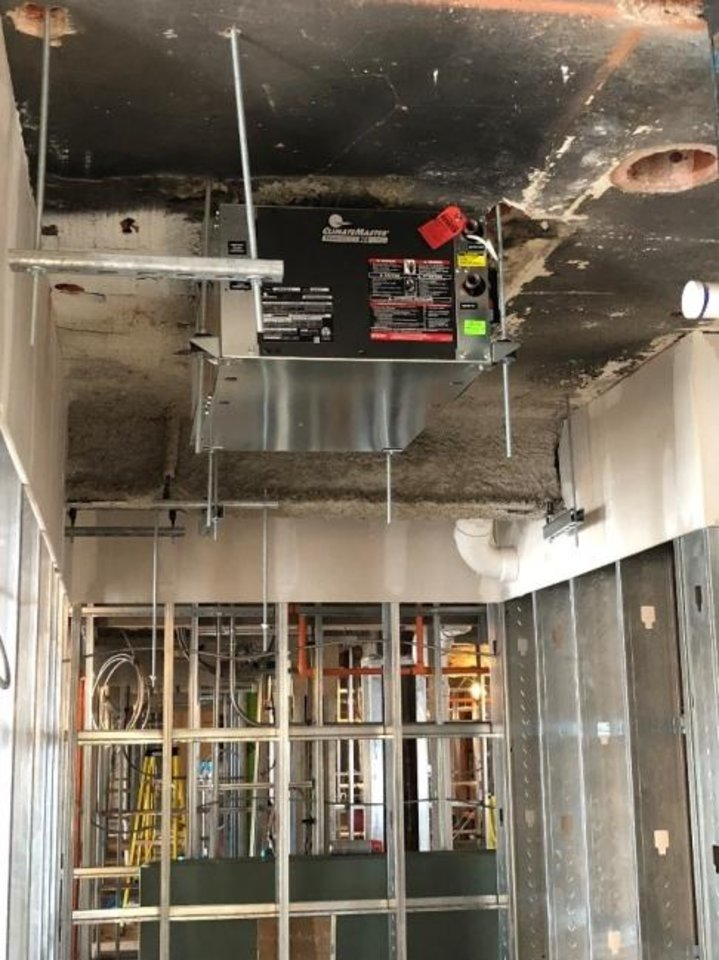 Photo -  New HVAC equipment installed inside the Tulsa Club is seen as its renovation continues. [PROVIDED BY THE ROSS GROUP]