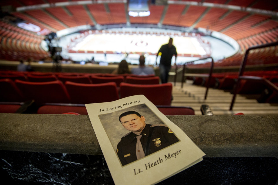 Photo -  The memorial services for Oklahoma Highway Patrol Lt. Heath Meyer were held at the Lloyd Noble Center in Norman in 2017. On Monday, D'angelo Burgess was convicted of Meyer's death. [Chris Landsberger/The Oklahoman Archives]