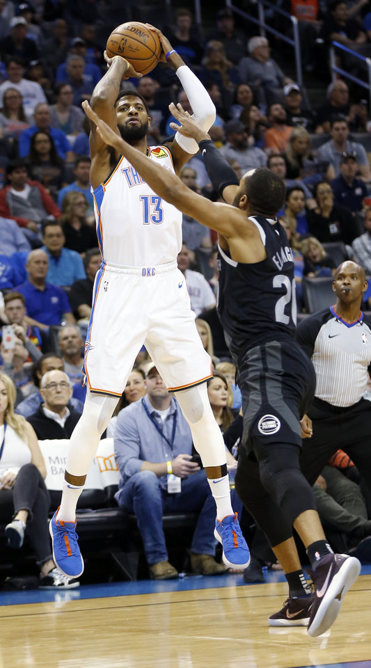 Photo - Oklahoma City's Paul George (13) shoots over Detroit's Wayne Ellington (20) in the first quarter during an NBA basketball game between the Detroit Pistons and the Oklahoma City Thunder at Chesapeake Energy Arena in Oklahoma City, Friday, April 5, 2019. Photo by Nate Billings, The Oklahoman