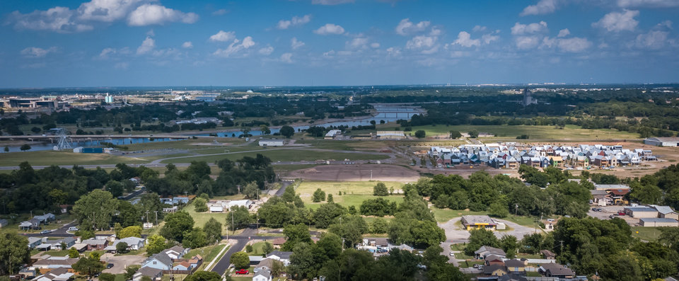 Photo -  The Jones Grove neighborhood, shown in the bottom half of this photo, will link up with Wheeler, seen on the right, where the future Western Gateway Elememtary will be built on cleared land shown in the center of this photo. [DAVE MORRIS/THE OKLAHOMAN]