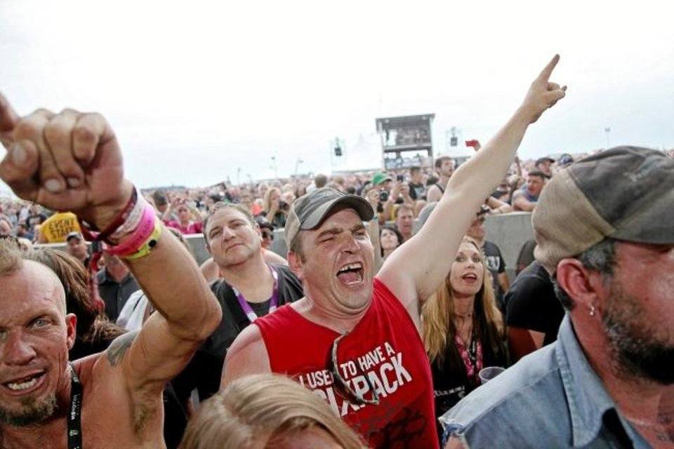 Photo -  Bryan Watkins, of Cushing, reacts to a performance by Seether during Rocklahoma in 2014. [John Clanton/Tulsa World Archives]