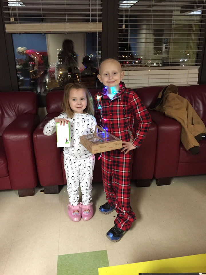 Photo -  Mia McDowell and Charlie Keith pose on Christmas Eve last year at the pajama party hosted by 10 Strong. Keith died Sept. 7 of complications from cancer treatment. Mia is in remission and attending kindergarten. [Photo provided]