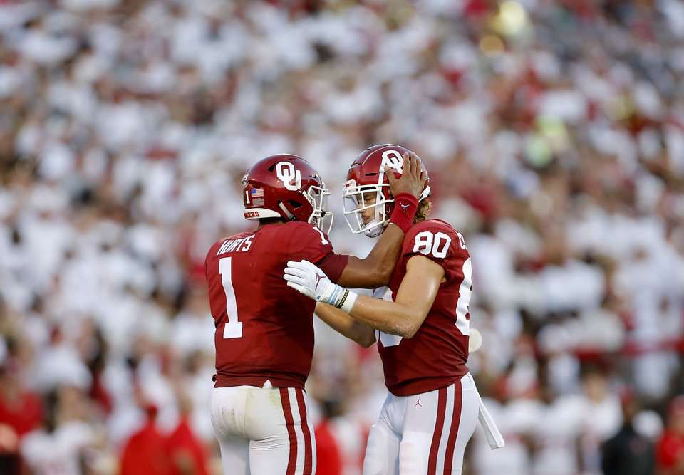 Photo - Oklahoma's Jalen Hurts (1) and Grant Calcaterra (80) celebrate a play in the second quarter during a college football game between the University of Oklahoma Sooners (OU) and the Houston Cougars at Gaylord Family-Oklahoma Memorial Stadium in Norman, Okla., Sunday, Sept. 1, 2019. [Sarah Phipps/The Oklahoman]