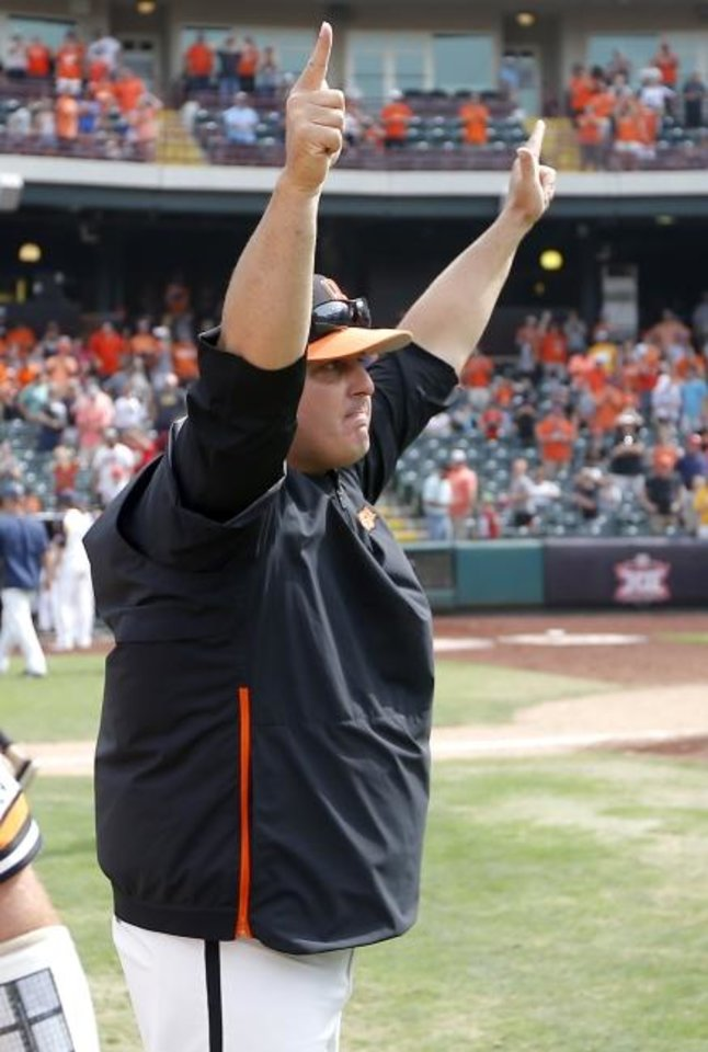 Photo -  Oklahoma State baseball coach Josh Holliday celebrates with the crowd on Sunday after the Cowboys won the Big 12 Tournament title over West Virginia at Chickasaw Bricktown Ballpark. [Sarah Phipps/The Oklahoman]