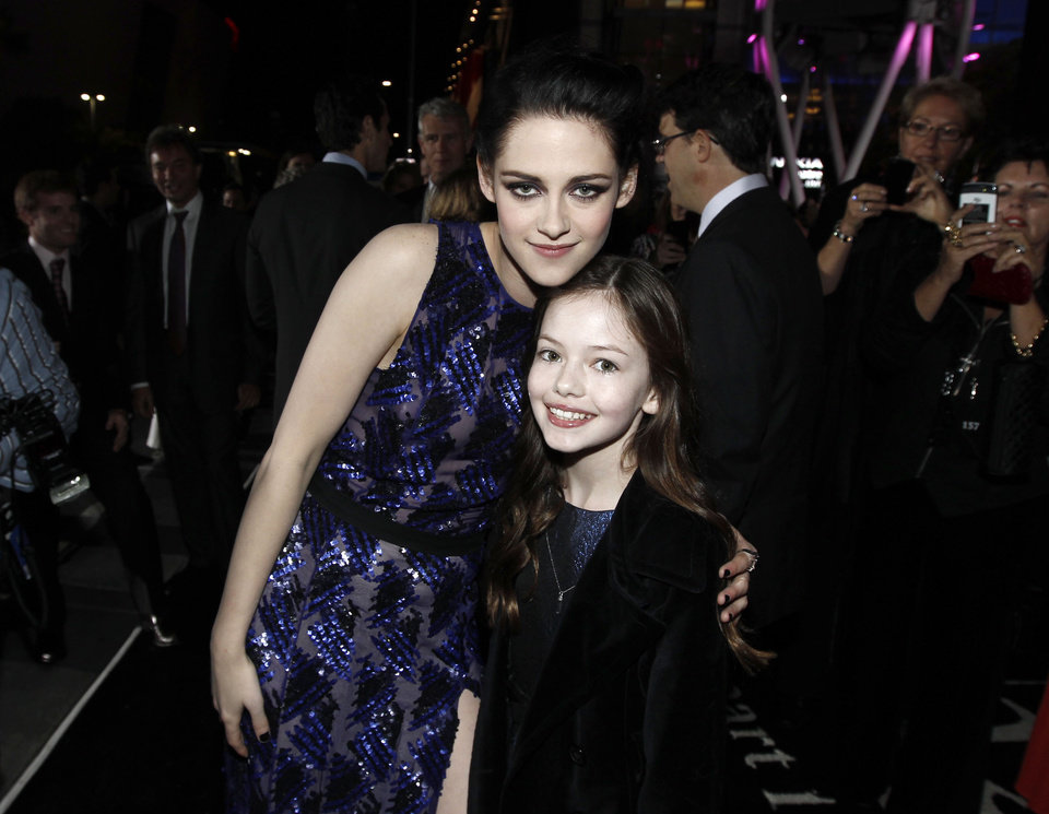 Photo - Kristen Stewart, left, and Mackenzie Foy arrive at the world premiere of