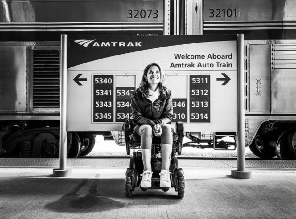 Photo -  Sylvia Longmire is shown at the Lorton, Va., Amtrak station. Longmire was one of six winners of Amtrak's