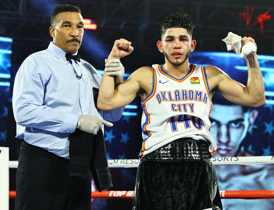Photo - Alex Saucedo sports a No. 140 Oklahoma City Thunder jersey after defeating Sonny Fredrickson by unanimous decision Tuesday night at MGM Grand in Las Vegas. [HECTOR DELACRUZ/TOP RANK]