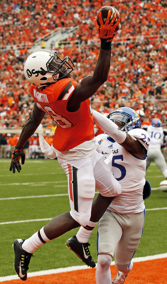 Photo - Oklahoma State's James Washington (28) makes a touchdown catch with one hand in front of Kansas' Marnez Ogletree (25) during the second quarter of a college football game between the Oklahoma State University Cowboys (OSU) and the Kansas Jayhawks (KU) at Boone Pickens Stadium in Stillwater, Okla., Saturday, Oct. 24, 2015. Photo by Nate Billings, The Oklahoman