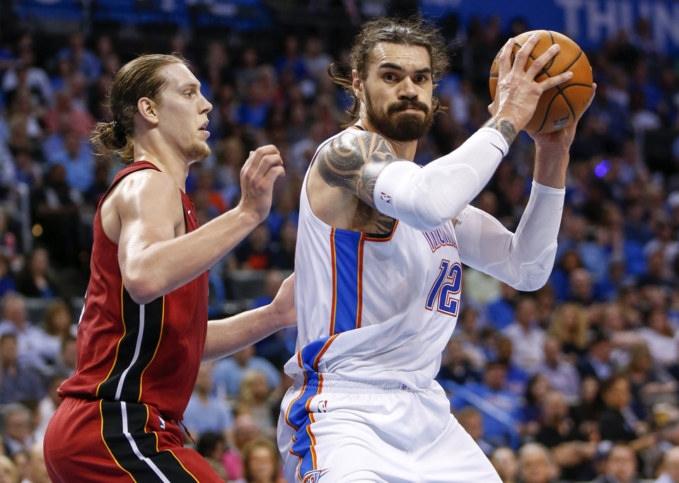 Photo -  Oklahoma City's Steven Adams works against Miami's Kelly Olynyk during Friday's game at Chesapeake Energy Arena. [Photo by Nate Billings, The Oklahoman]
