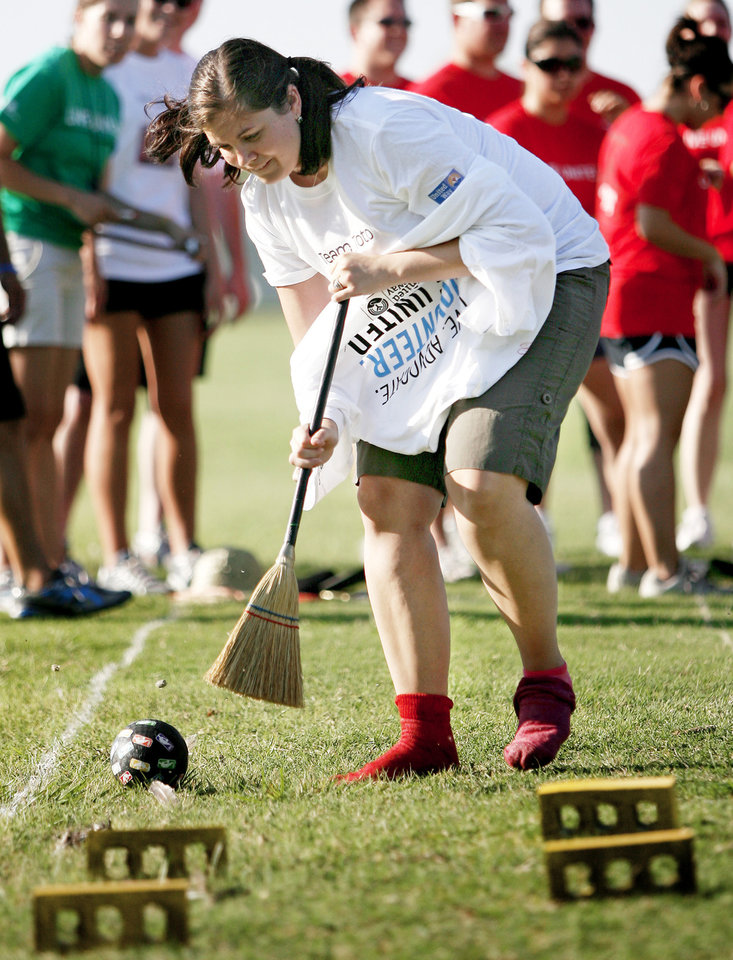 "Photo - Regina Harwell with Valliance Bank competes Tuesday in the ""Traveling Down the Yellow Brick Road"" event during the United Way Pacesetter Games in Oklahoma City. Photos by Bryan Terry, The Oklahoman"