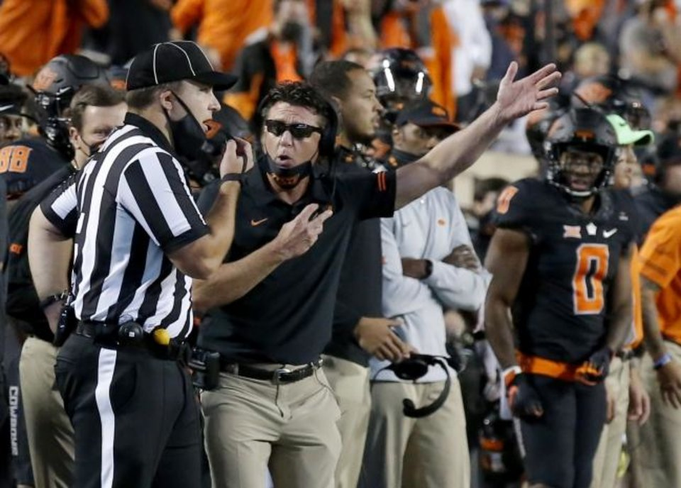 Photo -  Oklahoma State coach Mike Gundy argues a penalty in overtime of a 41-34 loss to Texas on Saturday in Stillwater. [Sarah Phipps/The Oklahoman]