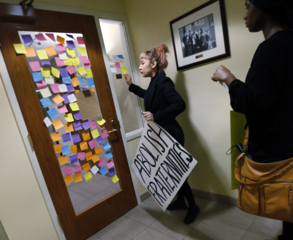 Photo - Students at the University of Oklahoma place notes on the door of the Office of Student Affairs in protest of racist comments made by a fraternity on March 9, 2015 in Norman, Okla. Photo by Steve Sisney, The Oklahoman