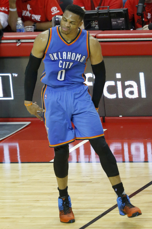 Photo - Oklahoma City's Russell Westbrook (0) reacts after a 3-point basket during Game 2 in the first round of the NBA playoffs between the Oklahoma City Thunder and the Houston Rockets in Houston, Texas,  Wednesday, April 19, 2017.  Photo by Sarah Phipps, The Oklahoman