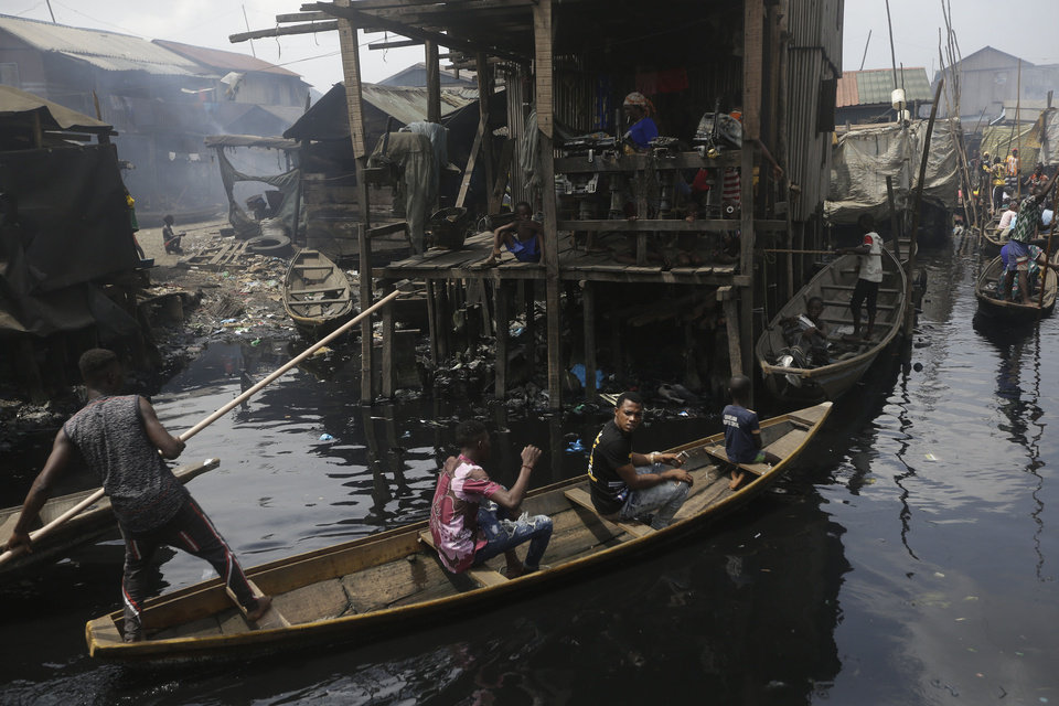 Photo -  In this March 21 photo, people travel by canoe during a coronavirus lockdown in the floating slum of Makoko in Lagos, Nigeria. [Associated Press File]