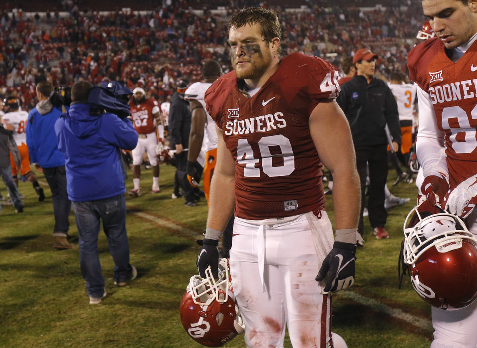 Photo - Oklahoma's Aaron Ripkowski (48) walks off the field after a Bedlam college football game between the University of Oklahoma Sooners (OU) and the Oklahoma State Cowboys (OSU) at Gaylord Family-Oklahoma Memorial Stadium in Norman, Okla., Saturday, Dec. 6, 2014. Photo by Bryan Terry, The Oklahoman