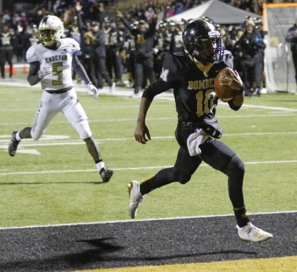 Photo -  Midwest City quarterback DeAngelo Irvin Jr. (10) runs in for a touchdown in the second quarter Friday against Choctaw. [Nate Billings/The Oklahoman]