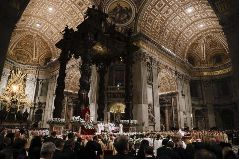 Photo - Pope Francis presides over a solemn Easter vigil ceremony in St. Peter's Basilica at the Vatican, Saturday, April 21, 2019. (AP Photo/Gregorio Borgia)