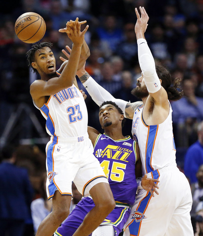 Photo - Oklahoma City's Terrance Ferguson (23) and Steven Adams (12), right, collide with Utah's Donovan Mitchell (45) during an NBA basketball game between the Utah Jazz and the Oklahoma City Thunder at Chesapeake Energy Arena in Oklahoma City, Monday, Dec. 10, 2018. Photo by Nate Billings, The Oklahoman