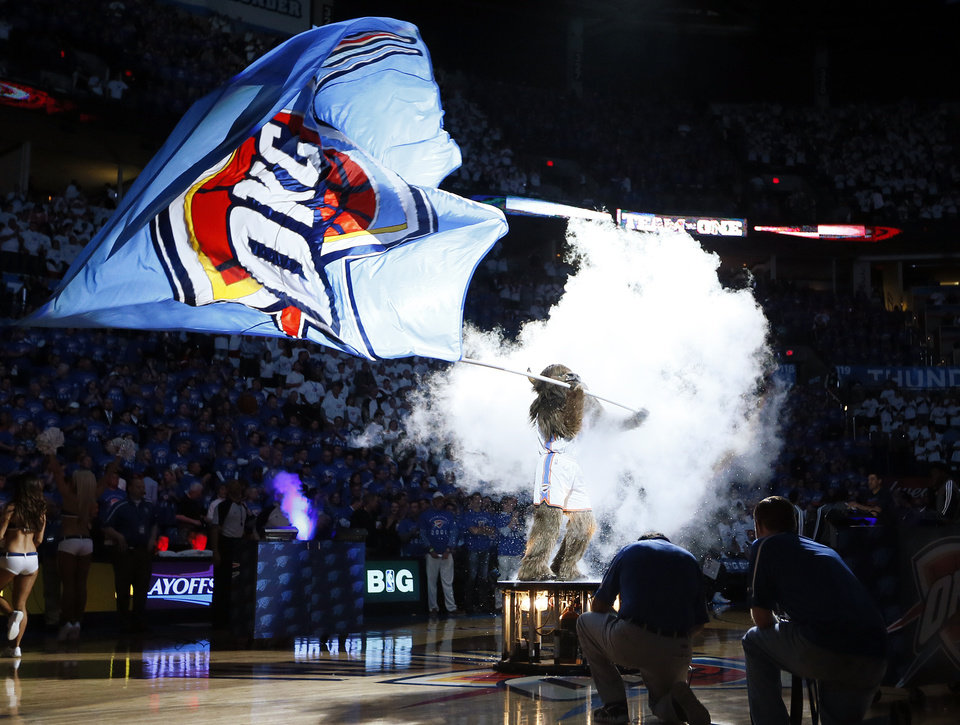 Photo - Thunder mascot Rumble the Bison waves an OKC flag before Game 2 in the first round of the NBA playoffs between the Oklahoma City Thunder and the Houston Rockets at Chesapeake Energy Arena in Oklahoma City, Wednesday, April 24, 2013. Photo by Nate Billings, The Oklahoman