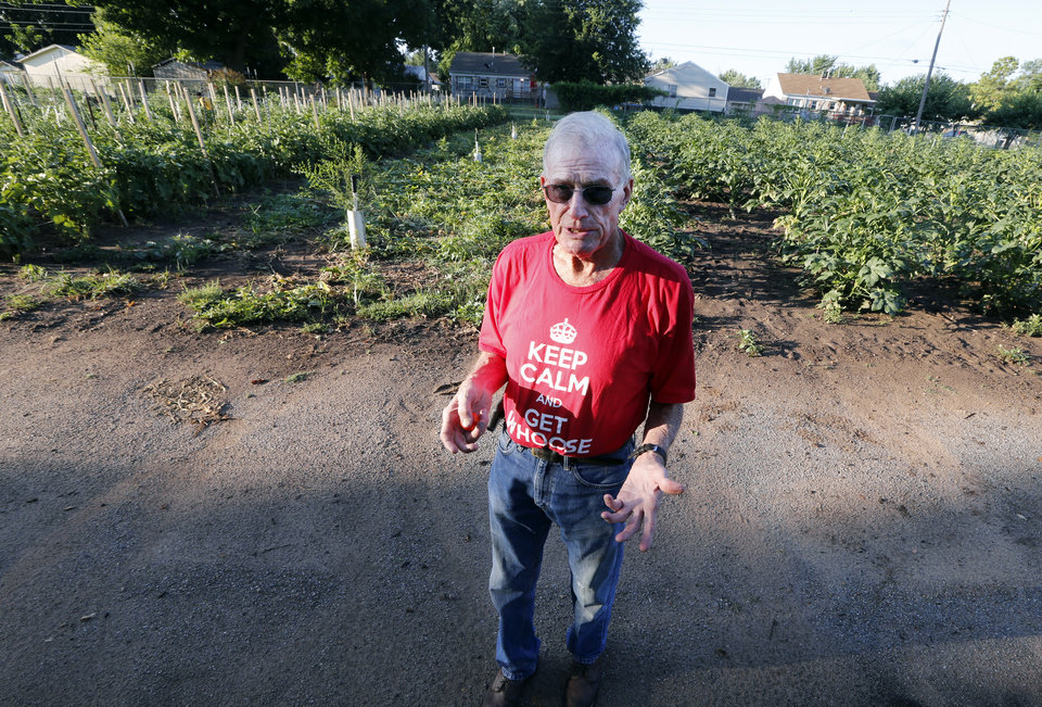 Photo -  Melvin Thompson stands near plants in Del City Church of Christ's extensive community garden. [Photo by Steve Sisney, The Oklahoman]