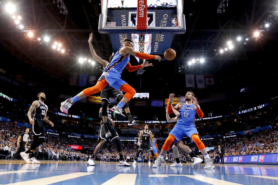 Photo - Oklahoma City's Russell Westbrook (0) passes the ball during an NBA basketball game between the Oklahoma City Thunder and the Brooklyn Nets at Chesapeake Energy Arena in Oklahoma City, Wednesday, March 13, 2019. Oklahoma City won 108-96. Photo by Bryan Terry, The Oklahoman
