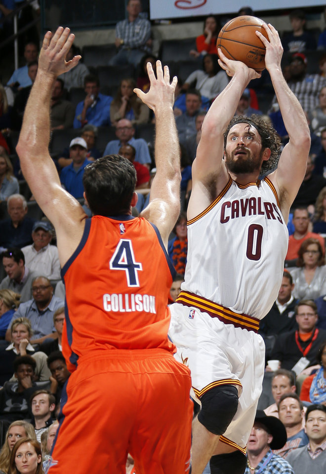 Photo - Cleveland's Kevin Love (0) shoots over Oklahoma City's Nick Collison (4) during an NBA basketball game between the Oklahoma City Thunder and the Cleveland Cavaliers at Chesapeake Energy Arena in Oklahoma City, Sunday, Feb. 21, 2016. Oklahoma City lost 115-92.  Photo by Bryan Terry, The Oklahoman