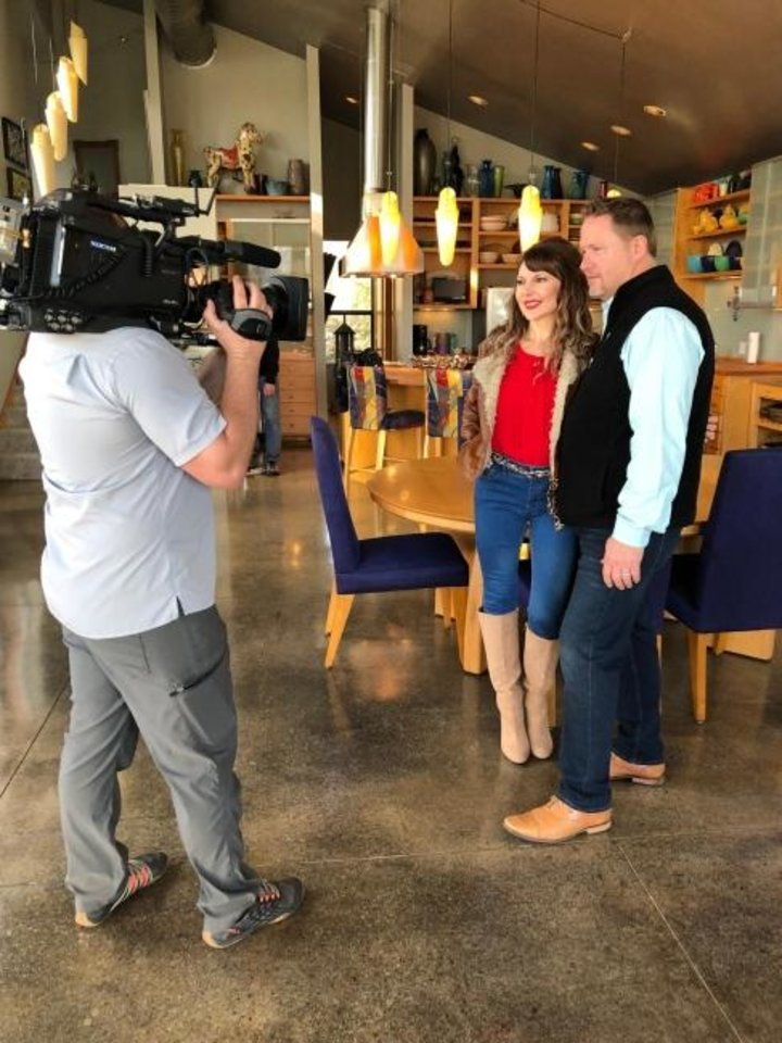 Photo -  Camera operator Chris McCaffrey records Oklahoma City real estate agents Denise and Troy Schroder for another appearance on HGTV's