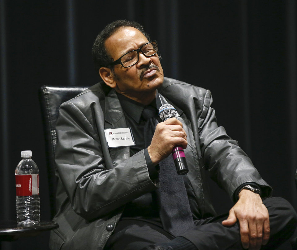 Photo - Michael Baldwin pauses while speaking during a panel discussion of former students who were expelled from then Oklahoma Christian College and arrested in 1969 after the Benson Hall sit-in to protest the expulsion of black basketball players who were accused of attending an interracial gathering off campus, at Oklahoma Christian University's Judd Theatre in Oklahoma City, Wednesday, March 6, 2019. Baldwin is one of what OC calls Oklahoma Christian's 18. Photo by Nate Billings, The Oklahoman