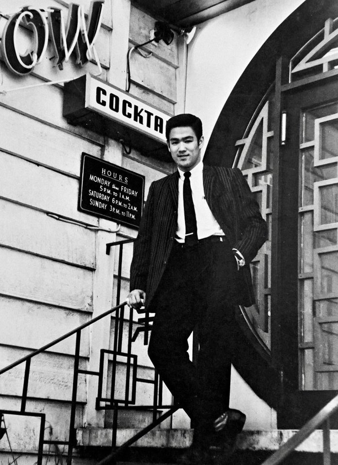 Photo -  Bruce Lee poses outside Ruby Chow's restaurant in Seattle, the first Chinese restaurant outside of the city's Chinatown. [David Tadman]