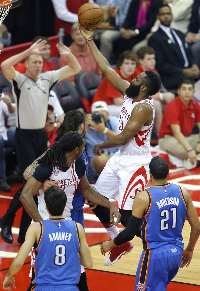 Photo - Houston's James Harden (13) goes to the basket during Game 2 in the first round of the NBA basketball playoffs between the Oklahoma City Thunder and the Houston Rockets at the Toyota Center in Houston, Texas,  Wednesday, April 19, 2017.  Photo by Sarah Phipps, The Oklahoman