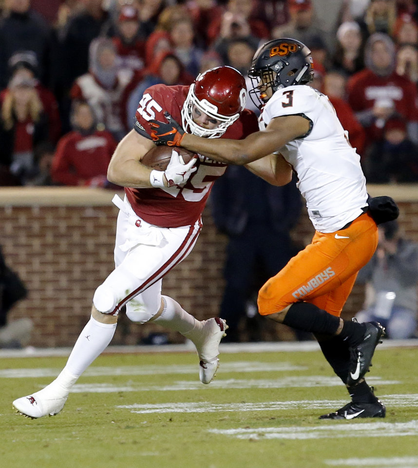 Photo - Oklahoma State's Blake Barron (45) tries to get by Oklahoma State's Kenneth Edison-McGruder (3) in the fourth quarter during a Bedlam college football game between the University of Oklahoma Sooners (OU) and the Oklahoma State University Cowboys (OSU) at Gaylord Family-Oklahoma Memorial Stadium in Norman, Okla., Nov. 10, 2018.  OU won 48-47. Photo by Sarah Phipps, The Oklahoman