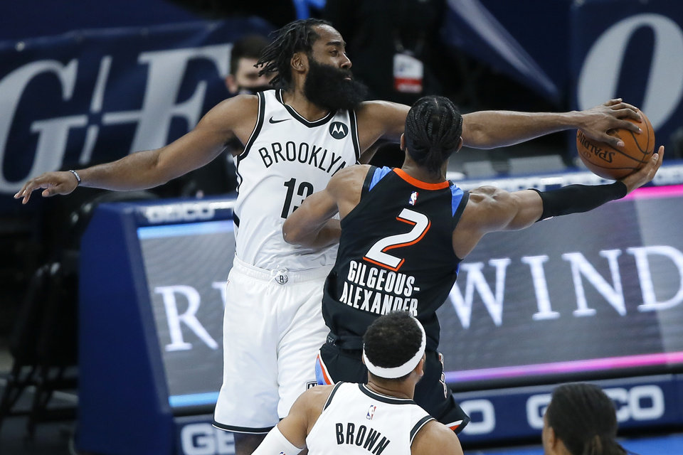 Photo - Brooklyn's James Harden (13) blocks the shot of Oklahoma City's Shai Gilgeous-Alexander (2) during an NBA basketball game between the Oklahoma City Thunder and the Brooklyn Nets at Chesapeake Energy Arena in Oklahoma City, Friday, Jan. 29, 2021. [Bryan Terry/The Oklahoman]