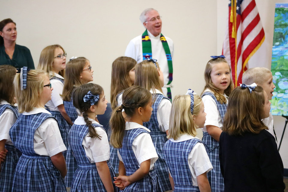 Photo -  Students sing during the 40th anniversary celebration at St. Mary's Episcopal School in Edmond. [Photo by Doug Hoke, The Oklahoman]