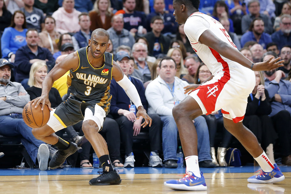Photo - Oklahoma City's Chris Paul (3) goes past Houston's Clint Capela (15) during an NBA basketball game between the Oklahoma City Thunder and Houston Rockets at Chesapeake Energy Arena in Oklahoma City, Thursday, Jan. 9, 2020. [Bryan Terry/The Oklahoman]