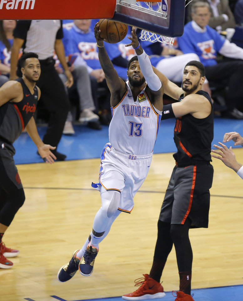 Photo - Oklahoma City's Paul George (13) goes to the basket past Portland's Enes Kanter (00) during Game 4 in the first round of the NBA playoffs between the Portland Trail Blazers and the Oklahoma City Thunder at Chesapeake Energy Arena in Oklahoma City, Sunday, April 21, 2019. Photo by Bryan Terry, The Oklahoman
