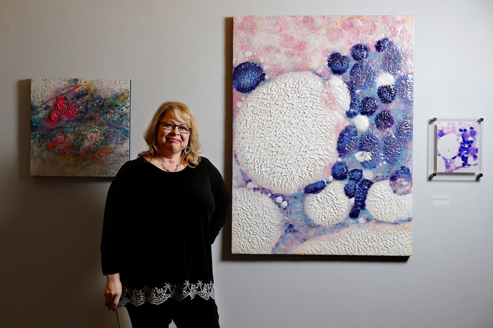 "Photo -  Oklahoma City artist Gayle Curry on Dec. 18 stands next to her painting ""Cancer picked the wrong Mother (Phyllis Curry, mother, fighter & leukemia survivor),"