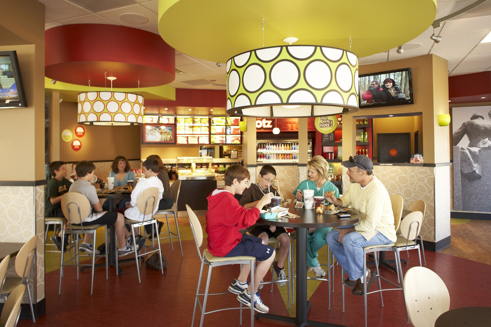Photo - RESTAURANT / BAKERY / COMBO / STORE: The interior of a redesigned Schlotzky's restaurant is co-branded with Cinnabon. - PHOTO PROVIDED BY SCHLOTZKY'S     ORG XMIT: 1004292223331104