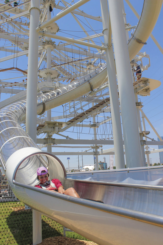 Photo -  Rocketing down a water slide at Riversport OKC. [Provided by Georgia Read]
