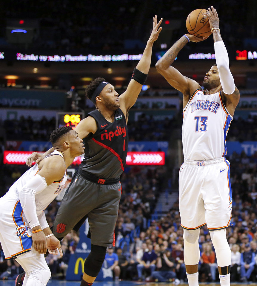 2324b8d921a Oklahoma City s Paul George (13) takes a three-point shot against  Portland s Evan Turner (1) next to Oklahoma City s Russell Westbrook (0) in  the fourth ...