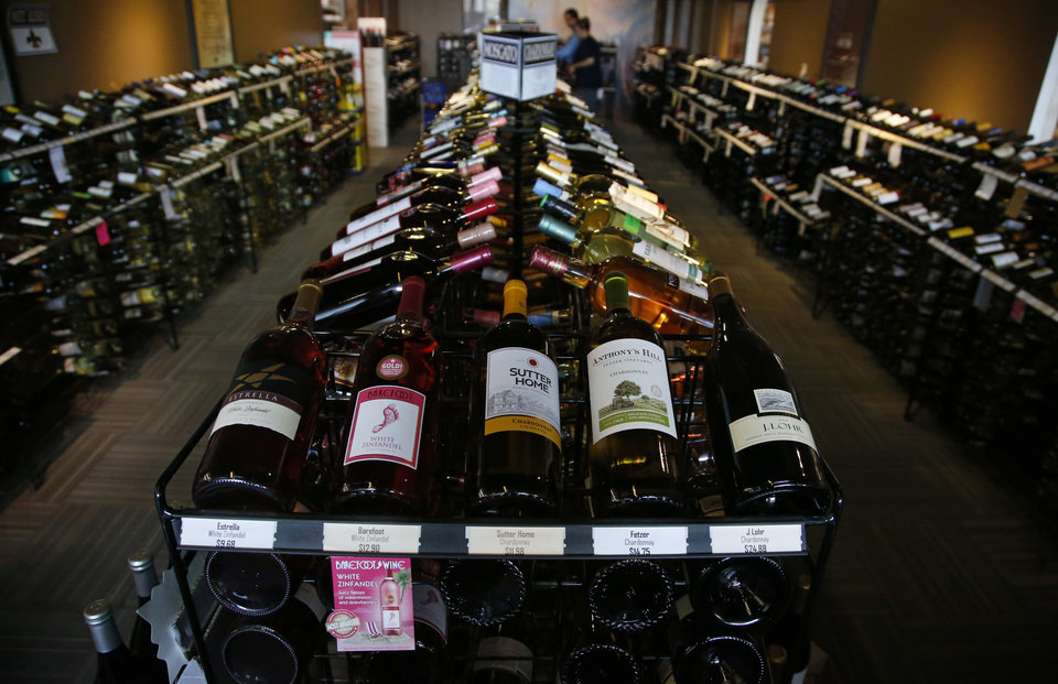Photo - CORRECTS NAME OF LIQUOR STORE The wine room at Moore Liquor is pictured in Moore, Okla., Thursday, Oct. 20, 2016. Changes to Oklahoma liquor laws are among the ballot measures facing voters this election. (AP Photo/Sue Ogrocki)